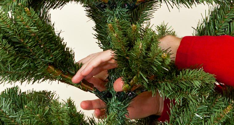 How to Shape an Artificial Christmas Tree | NorthPoleDecor.com Blog